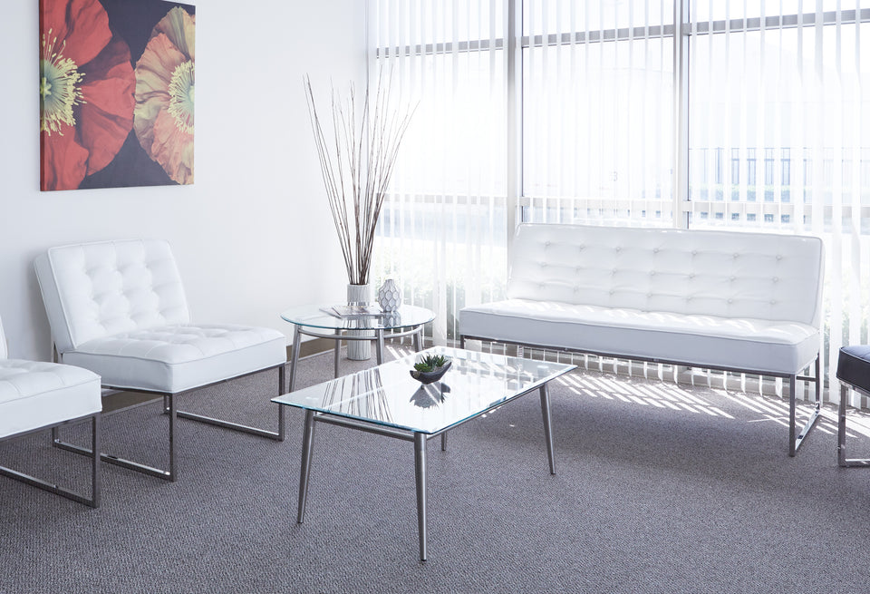 brooklyn round and rectangle coffee table in modern lounge area with white barcelona chairs