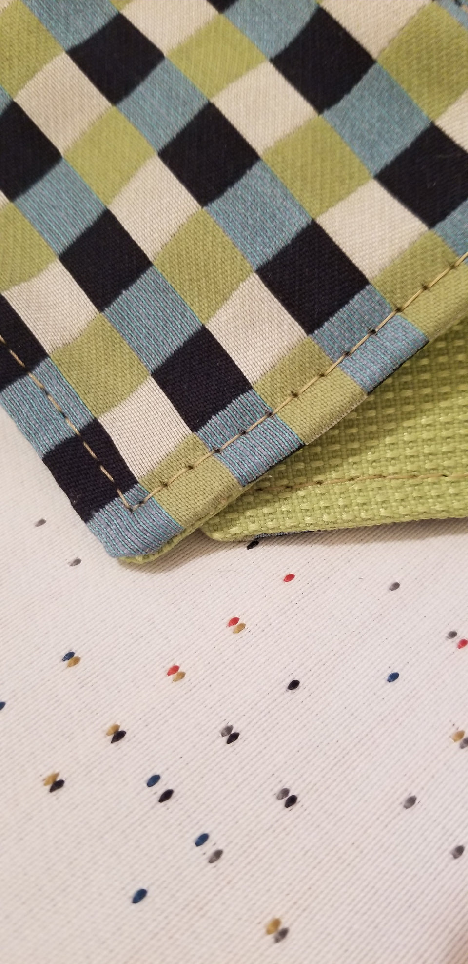 Chuck black, white, lime green, and turquoise gingham check patterned coasters detail view.