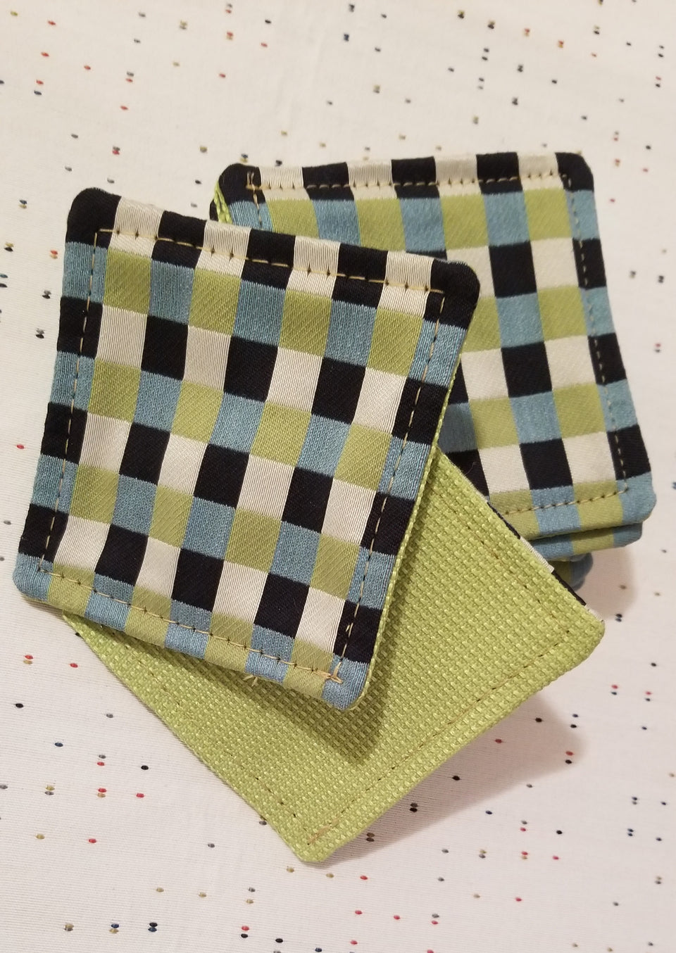 Chuck black, white, lime green, and turquoise gingham check patterned coasters front back detail.