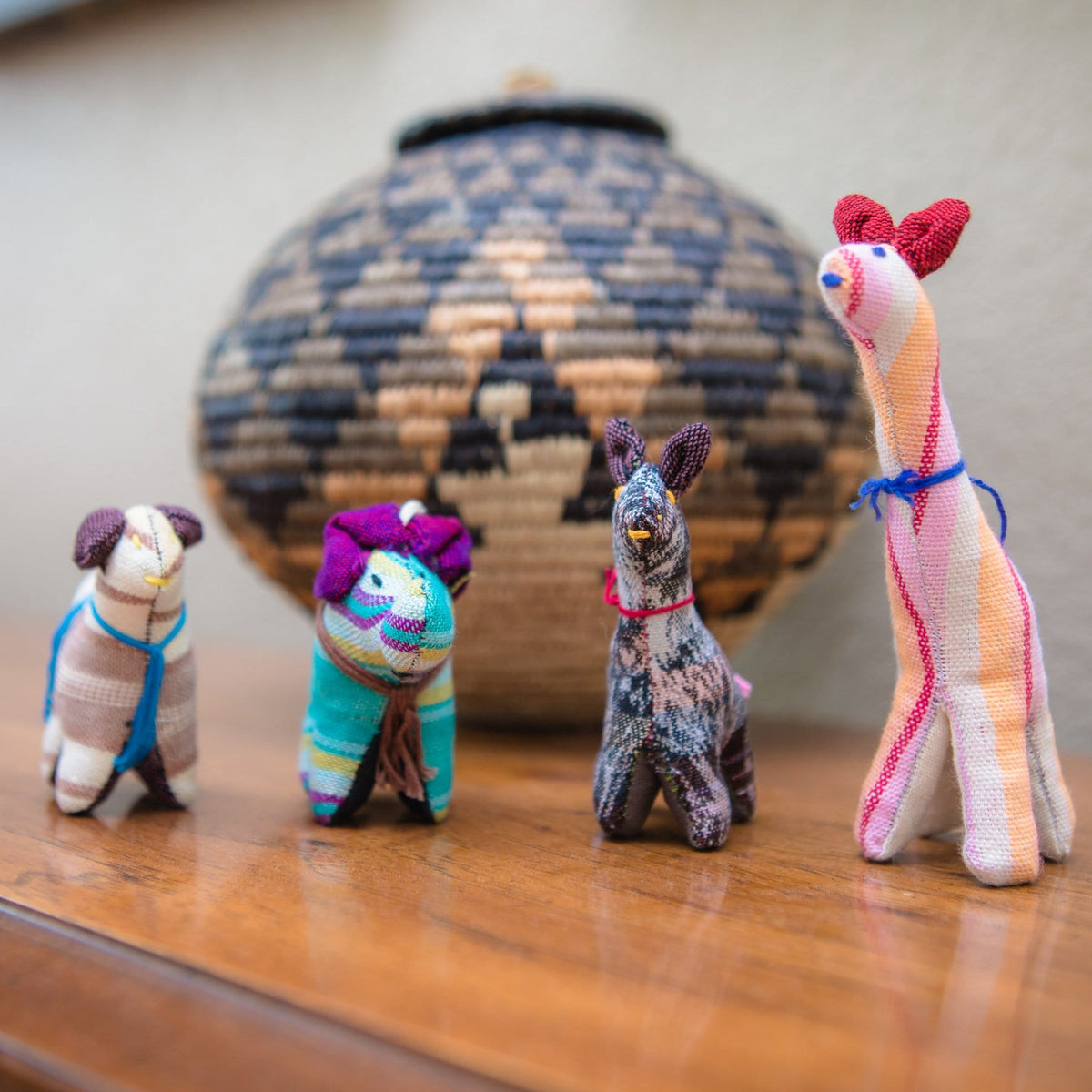 Group of Fair Trade Handmade Cotton Animal Toys In Use Lifestyle