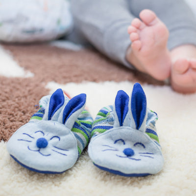 Baby Model with Blue Bunny Booties