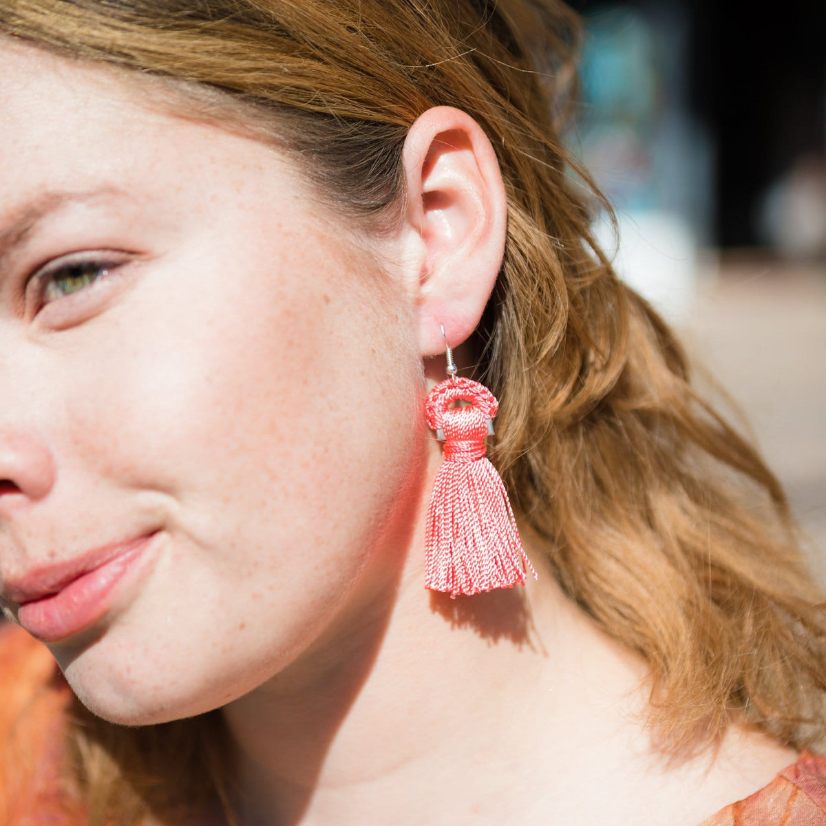 Model Wearing Tab Fringe Earrings