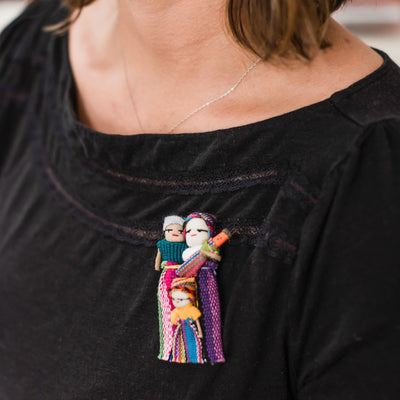 Model Wearing Fair Trade Migrant Family Pin