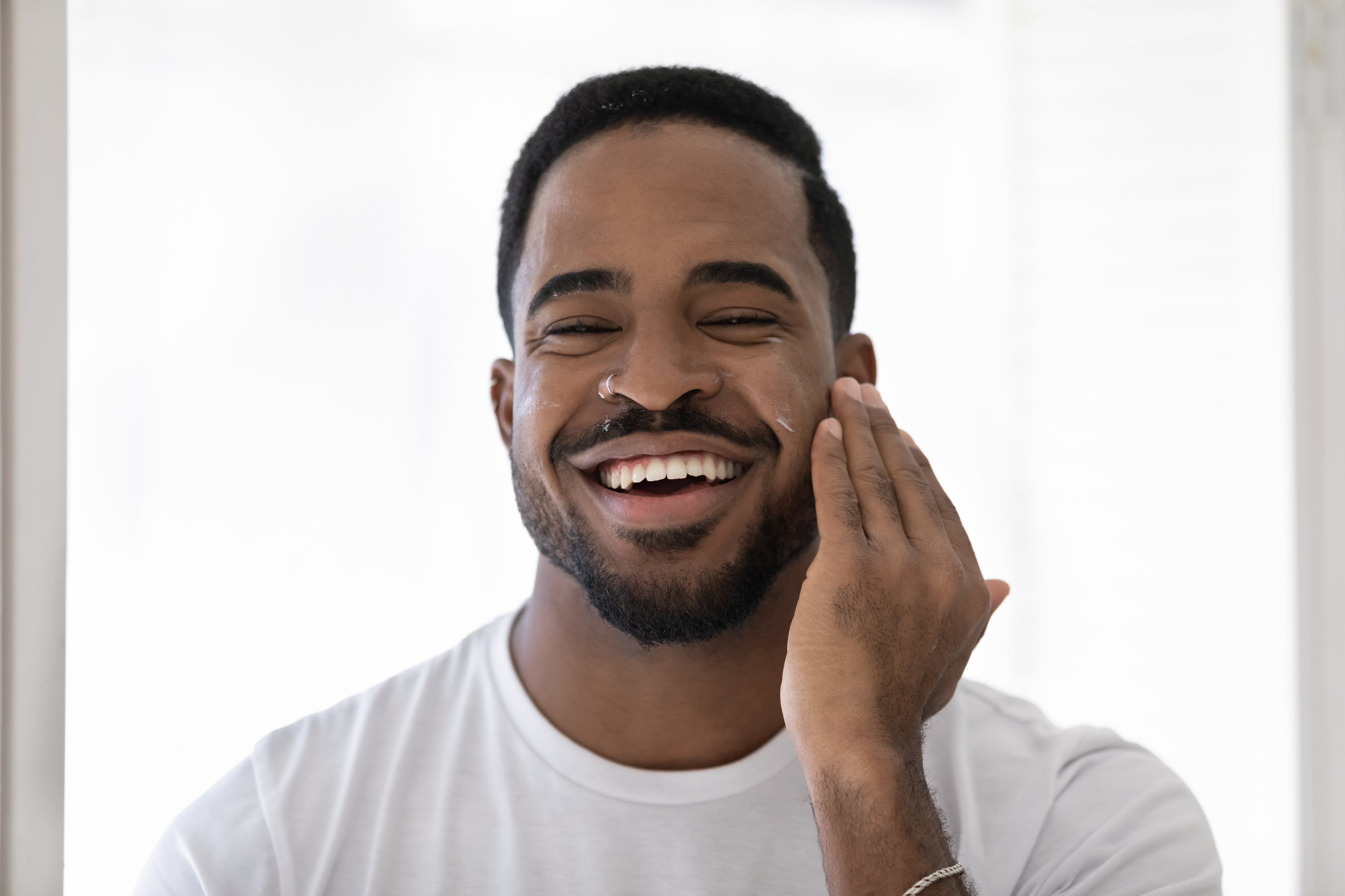 Man using 100% natural and organic Shea Butter & coconut oil fragranced moisturiser