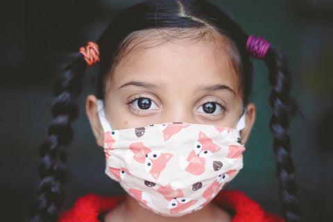 A girl wearing a cloth face mask