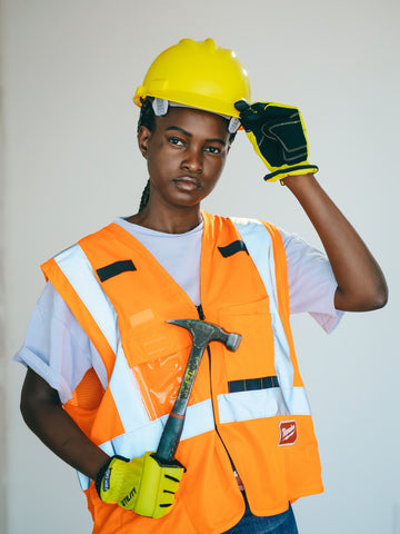 Woman wearing High Visibility Reflective Clothing