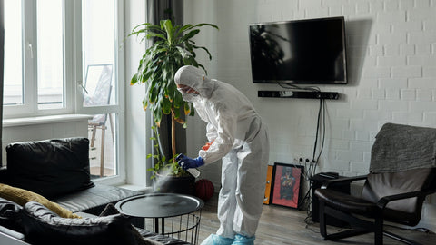 Cleanliness by a man wearing PPE