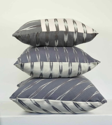 gray and white decorative cushions