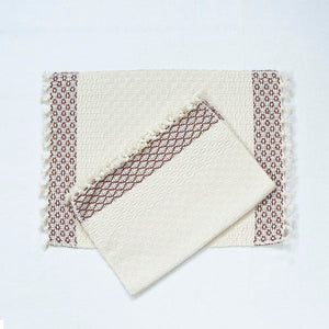 White placemats with red stripes along the edges