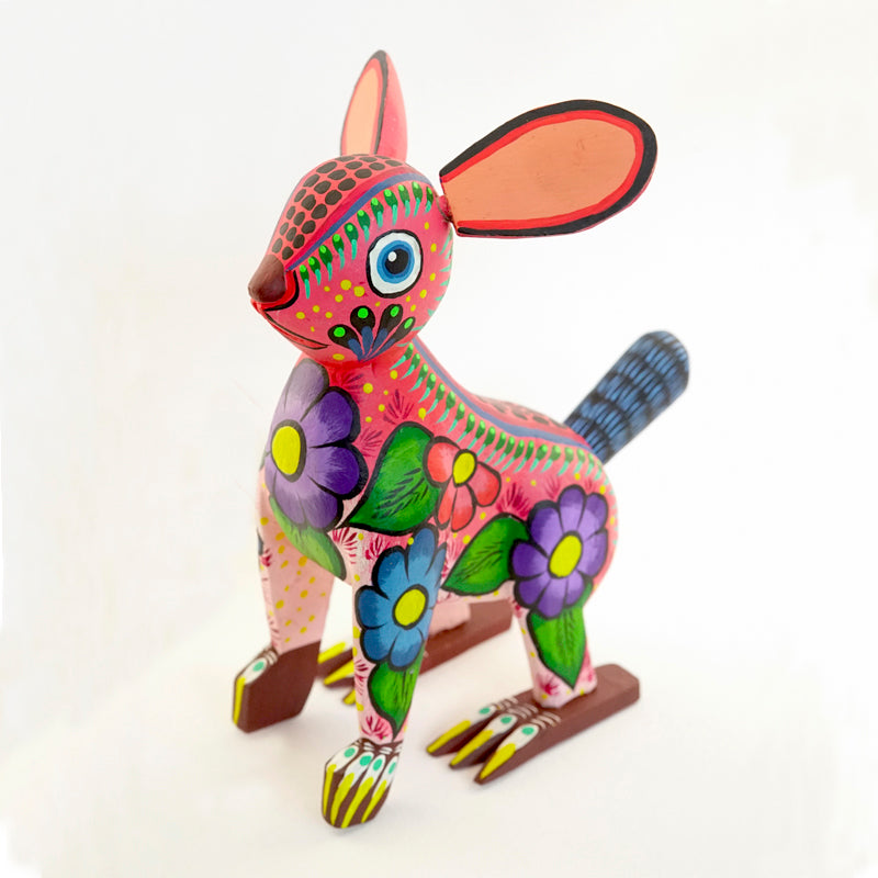 Colorful standing painted wooden rabbit figurine with floral details