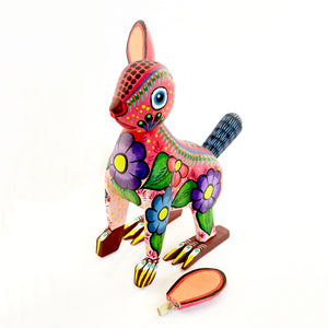 Removable ears next to their colorful standing painted wooden rabbit figurine with floral details