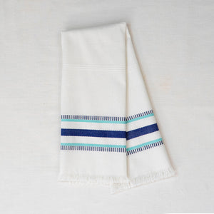 white tea towel with blue embroidered stripes