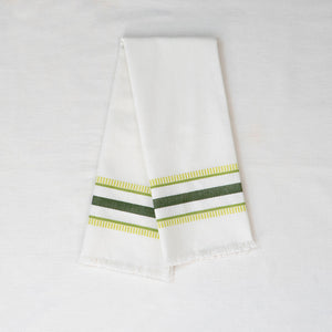 white tea towel with green embroidered stripes