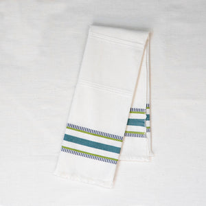 white tea towel with teal and green embroidered stripes