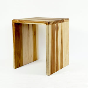 Small light-colored nesting bench made of sustainable teak wood.