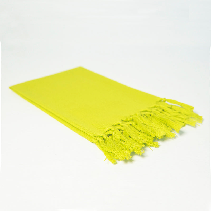 Reusable chartreuse cloth napkin handwoven by Guatemalan artisans out of 100% cotton with a fringe along one edge
