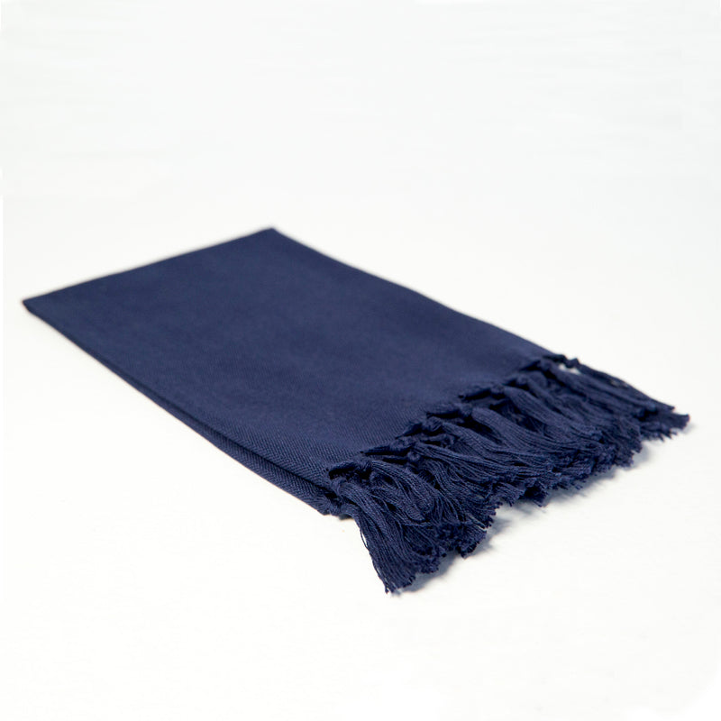 Reusable navy blue cloth napkin handwoven by Guatemalan artisans out of 100% cotton with a fringe along one edge