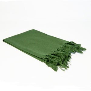 Reusable forest green cloth napkin handwoven by Guatemalan artisans out of 100% cotton with a fringe along one edge