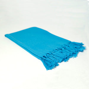 Reusable sky blue cloth napkin handwoven by Guatemalan artisans out of 100% cotton with a fringe along one edge