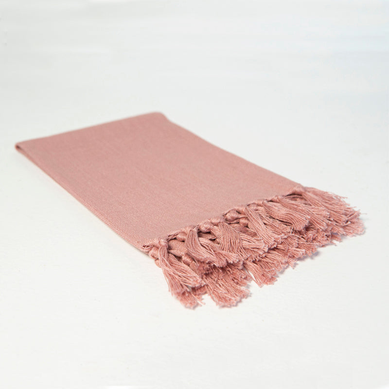 Reusable dusky rose-colored cloth napkin handwoven by Guatemalan artisans out of 100% cotton with a fringe along one edge