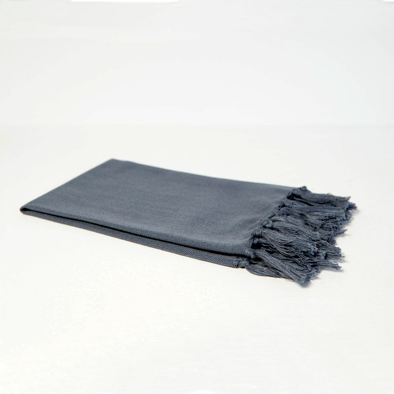 Reusable dark gray cloth napkin handwoven by Guatemalan artisans out of 100% cotton with a fringe along one edge