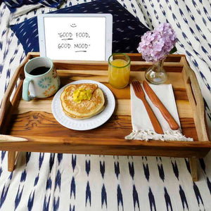 Foldable breakfast tray with reading rack made of wood with an iPad slot and a cooked breakfast