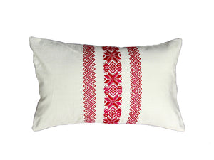 Lumbar pillow with white woven pillow cover with three coral red embroidered vertical designs