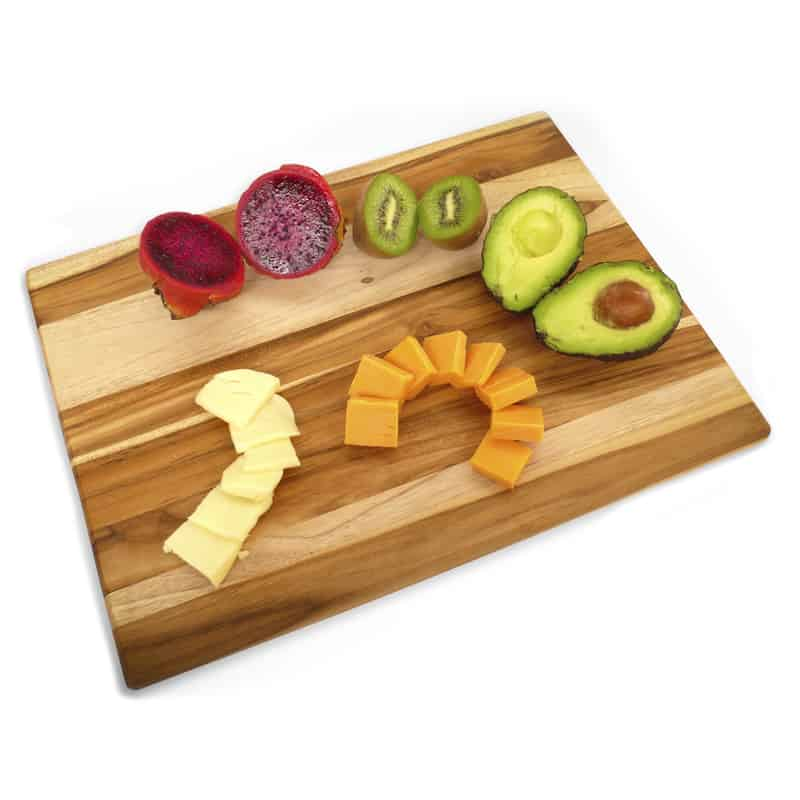 exotic wood cutting board made of teak with various fruits and cheeses
