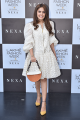 Simran Luthria in Ivory Dress With Puff Sleeves