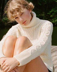 TAYLOR MADE - ARAN JUMPERS ARE A HIT IN BOTH MUSIC AND FILMS
