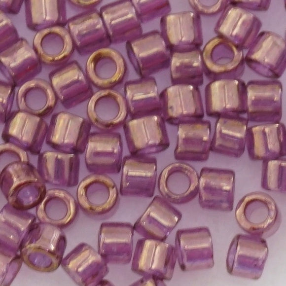 9 grammes of Size 10 Delica DBM108 Gold Luster Amethyst