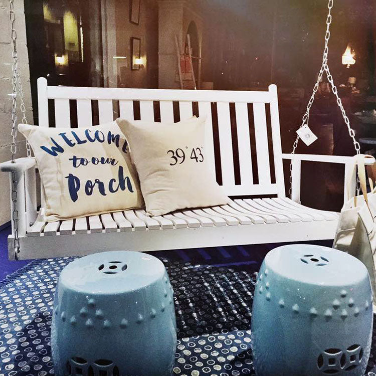 Dixie Seating Company white painted porch swing. Made in USA.