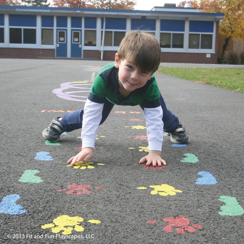 boy using his tactile pathways on an outdoor sensory pathway
