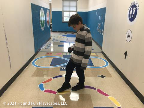 child on a fit and fun sensory pathway for schools