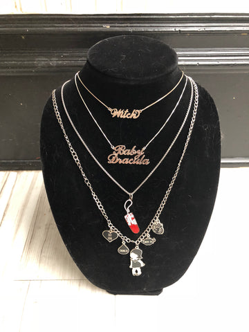 """Baby Dracula"" necklace."