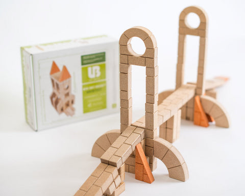 This is an image of Mini Unit bricks architectural 72 pc set with bridge and box. All unit bricks are sustainably grown hardwood.