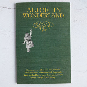 Green cloth Alice In Wonderland book design card with quotation from Alice's Adventures in Wonderland.