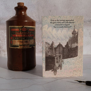 Stone ink bottle with a humorous card with characters from Pride and Prejudice.