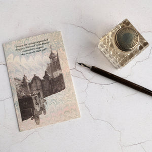 Travel humour card with glass inkwell and dip pen.