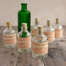 Load image into Gallery viewer, Small apothecary poison bottle featuring an original vintage label with a beautiful script design (Claud Manfull poison options)