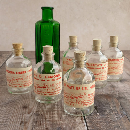 Small apothecary poison bottle featuring an original vintage label with a beautiful script design (Claud Manfull poison options)