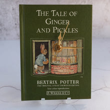 Load image into Gallery viewer, The Tale of Ginger & Pickles book clock featuring Beatrix Potter's Peter Rabbit.
