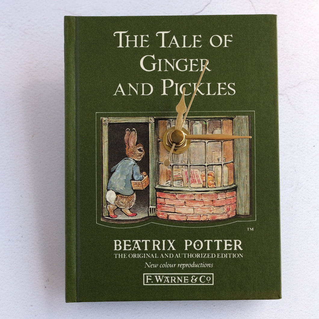 The Tale of Ginger & Pickles book clock featuring Beatrix Potter's Peter Rabbit.