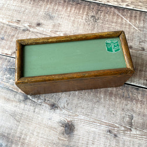Wooden painted green slide top box with vintage Foyles books label