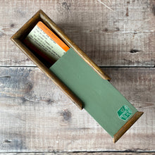 Load image into Gallery viewer, Wooden painted green slide top box with vintage Foyles books label