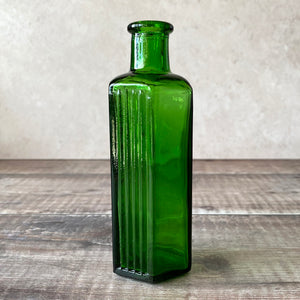 Green glass apothecary bottle NOT TO BE TAKEN