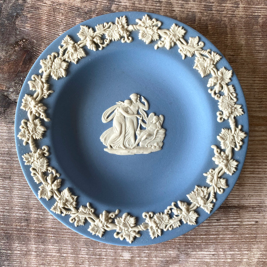 Small Wedgewood pin dish.  Blue with white decoration, classical scene.