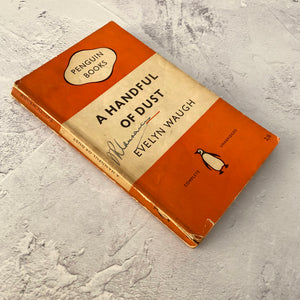 A Handful of Dust by Evelyn Waugh.  Penguin Books paperback 822.  1955.