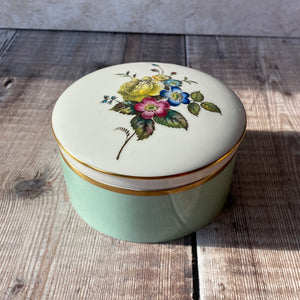 Royal Worcester fine bone china trinket box with floral lid.