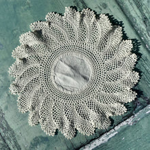 Load image into Gallery viewer, Beautiful circular vintage crochet doily with a starburst design.